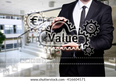"Glowing text ""Value"" in the hands of a businessman. Business concept. Internet concept."