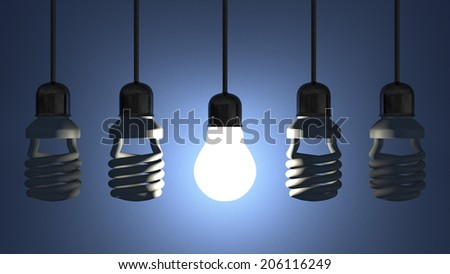 Glowing tungsten light bulb hanging among switched off fluorescent ones in sockets on wires on blue textured background - stock photo
