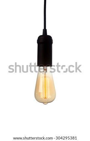 Glowing vintage light bulb isolated on white - stock photo