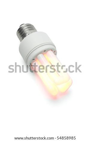 Glowing warm energy saving light bulb on white background - stock photo