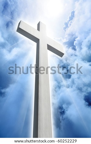 glowing white cross with rays of light - stock photo
