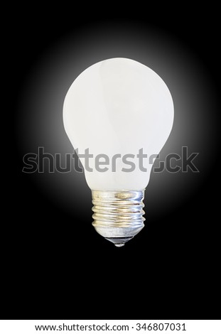 glowing white matte light bulb, isolated on black background