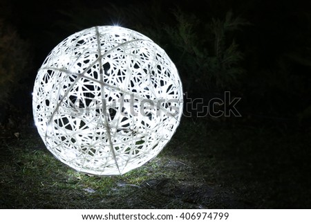 Glowing wicker ball at dusk - stock photo