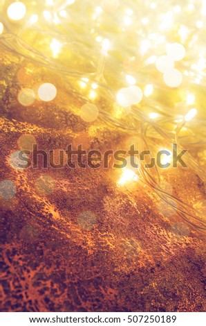 Glowing yellow Christmas lights background with copy space