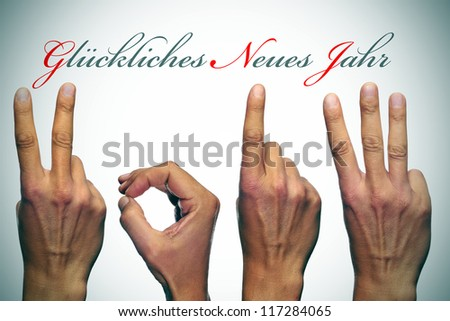 gluckliches neues jahr, happy new year written in german, with hands forming number 2013 - stock photo