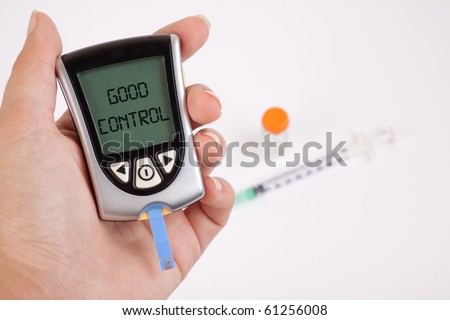 Glucometer showing a good result in the display - stock photo