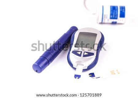 glucometer with test strips on it - stock photo