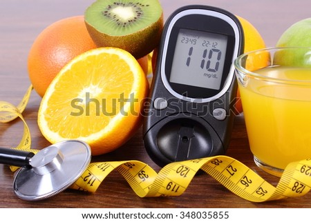 Glucose meter, medical stethoscope, fresh ripe fruits, glass of juice and tape measure, concept of diabetes and healthy lifestyles - stock photo