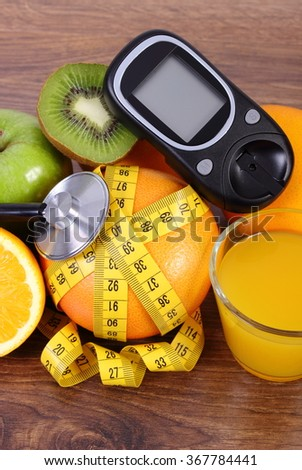 Glucose meter, medical stethoscope, fresh ripe fruits, glass of juice and tape measure, grapefruit orange kiwi apple, concept of diabetes and healthy lifestyles - stock photo