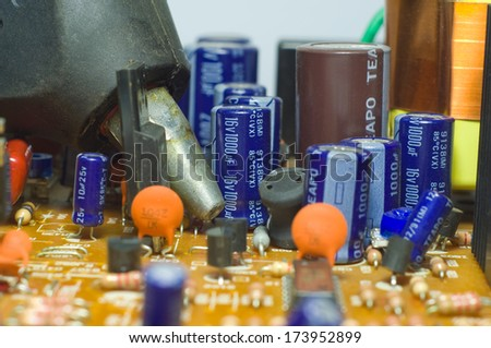 Glue gun on a chipset - stock photo