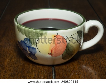 Gluhwein is usually prepared from red wine, heated and spiced with cinnamon sticks, cloves, star aniseed, citrus, sugar and at times vanilla pods. - stock photo
