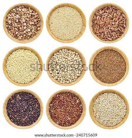 gluten free grains  - buckwheat, amaranth, brown rice, millet, sorghum, teff, black, red and white quinoa - isolated wooden bowls - stock photo