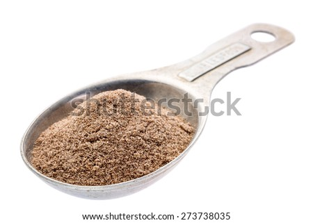 gluten free teff flour on an old aluminum measuring spoon isolated with a clipping path - stock photo