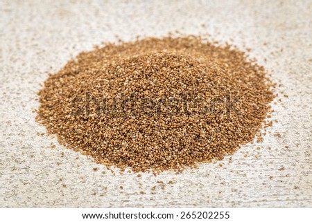 gluten free teff grain - a small pike against rustic barn wood - stock photo