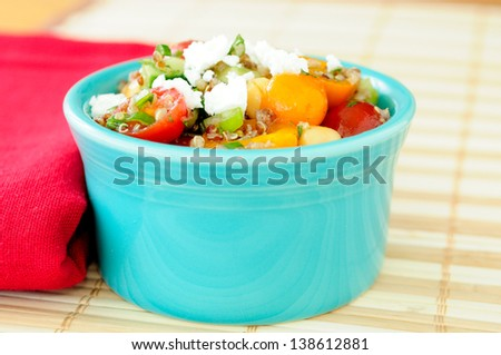 gluten free vegetarian salad made with quinoa, chickpeas, feta and fresh heirloom tomatoes