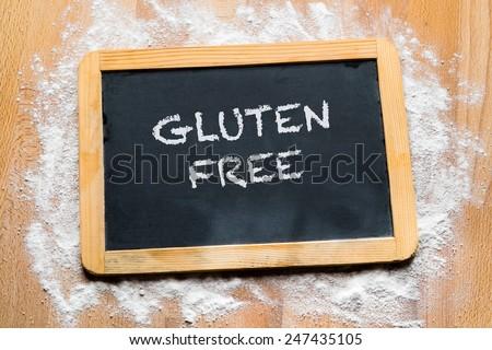 Gluten free written on a board - stock photo