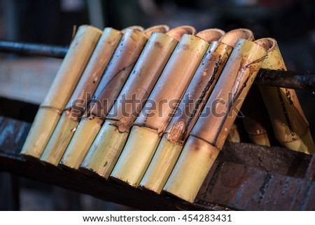 glutinous rice roasted in bamboo at night market in Thailand,khoalam.