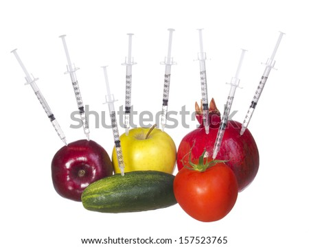 GMO food concept. Genetically modified fruit and vegetables with syringes isolated on white background. Genetic injections  - stock photo