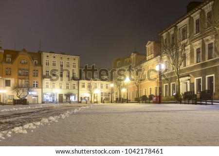 Gniezno, Poland, 03.07.2018 Old town sacred and secular buildings, architecture of the first polish capital. Night shots, winter and snow.