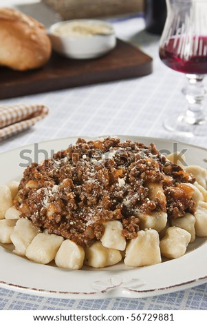Gnocchi Bolognese. Food photography. Italian cuisine accompanied by bolognese sauce. - stock photo