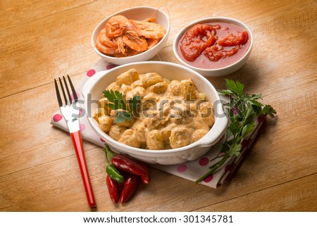 gnocchi with shrimp sauce and tomatoes - stock photo