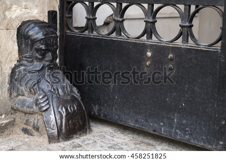 Gnome carriage stop in a Warsaw doorway. - stock photo