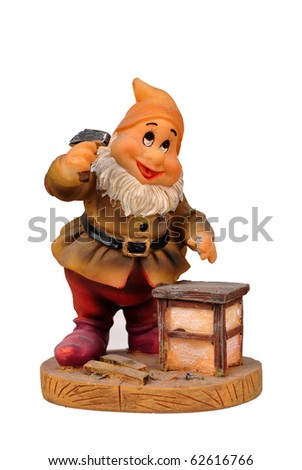 gnome with a white beard to work with hammer - stock photo
