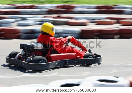 Go cart racer struggling on circuit