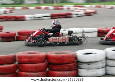 Go cart racers struggling at the piste - stock photo