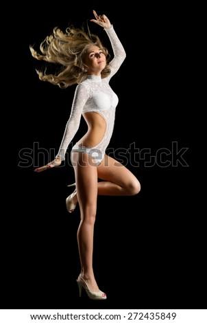 Go-go dancer in white costume isolated - stock photo