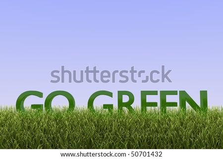 Go Green 3D text on grass against a blue sky. - stock photo