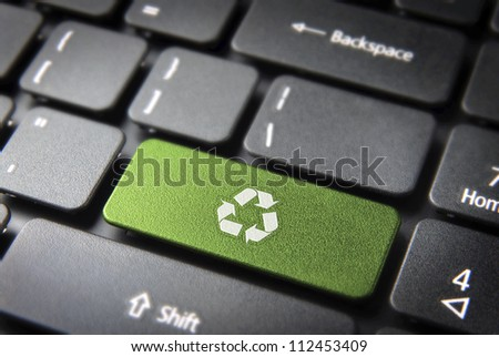 Go green key with wind turbine icon on laptop keyboard. Included clipping path, so you can easily edit it. - stock photo