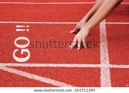 go - hands on starting line - stock photo