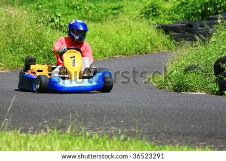 Go kart pilot turning left - stock photo