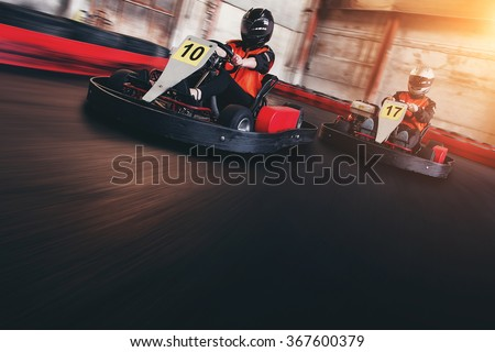 Go kart speed rive indor race opposition race - stock photo