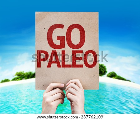 Go Paleo card with a beach on background - stock photo