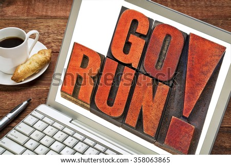 go run motivation fitness concept - isolated word abstract in letterpress wood type stained by red ink on a laptop - stock photo