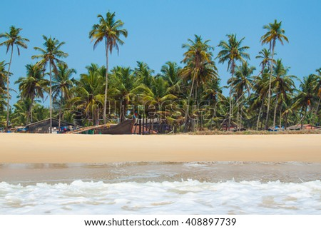 GOA Coast Landscape | Kolva, India - April 20, 2016: Goan beach panorama with sea, fisherman boats and palms