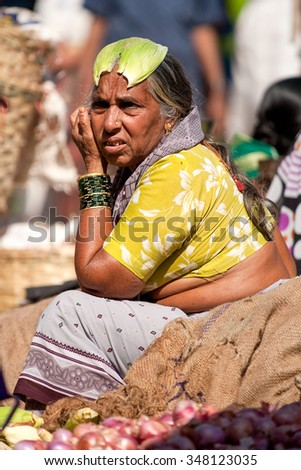 Goa, India - Circa February 2008 - Woman selling fresh vegetables at the famous weekly Mapusa Market