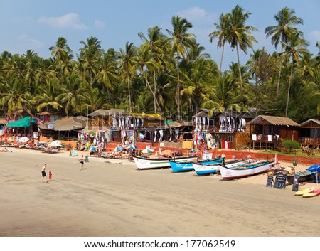 GOA, INDIA - JANUARY 31:Vacationers, sellers, cafe on the tropical beach Palolem, on January 31, 2014 in Goa, India - stock photo