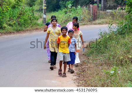 GOA,INDIA - OCTOBER 25,2011:Children walking in the street in the village of Anjuna