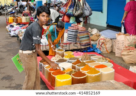 GOA,INDIA - OCTOBER 28,2011: the Guy the seller of spices at the Friday market in Mapusa in Goa
