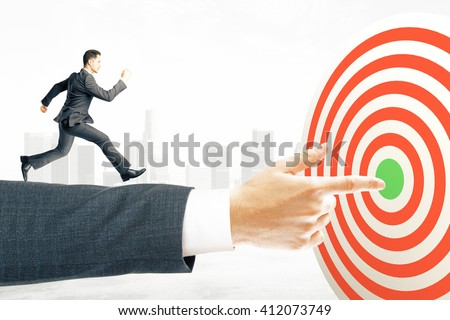 Goal concept with businessman miniature running towards target board - stock photo