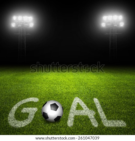 Goal concept with soccer ball and text on field against illuminated stadium lights on black - stock photo