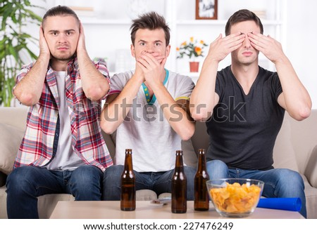 Goal. Group of sports fans watching game on TV at home. - stock photo