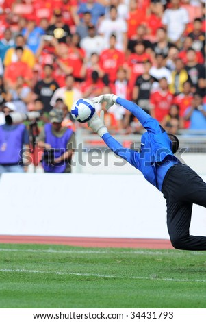 Goal Keeper in Action - stock photo