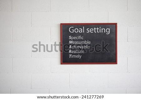 Goal setting, writing on chalkboard. Smart.  - stock photo