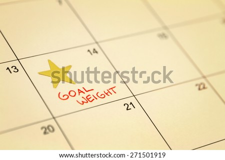Goal Weight Date on Calendar - stock photo