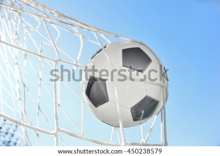 goal with a soccer ball in net and sky background  - stock photo