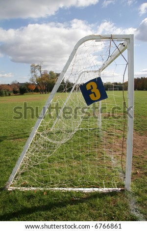 Goal with net stand on a soccer (or football) field. - stock photo